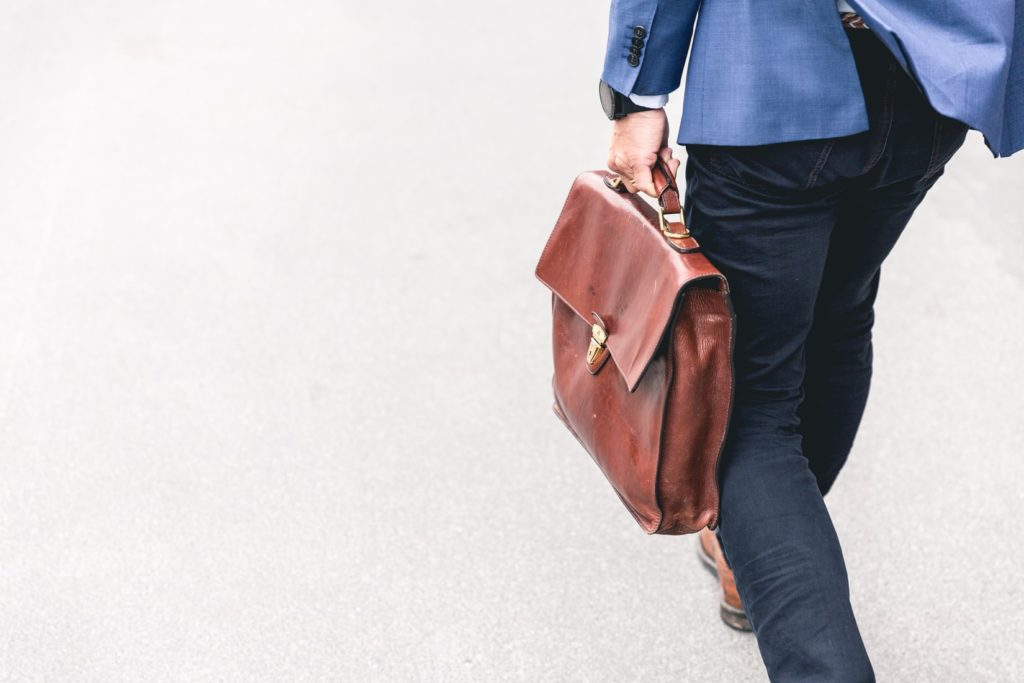 man walking with leather briefcase